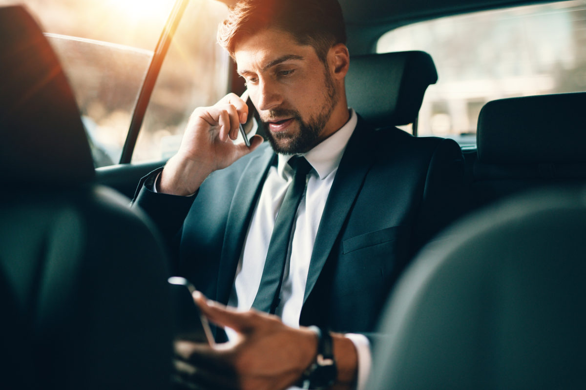 young businessman using a professionally driven car service in Toronto
