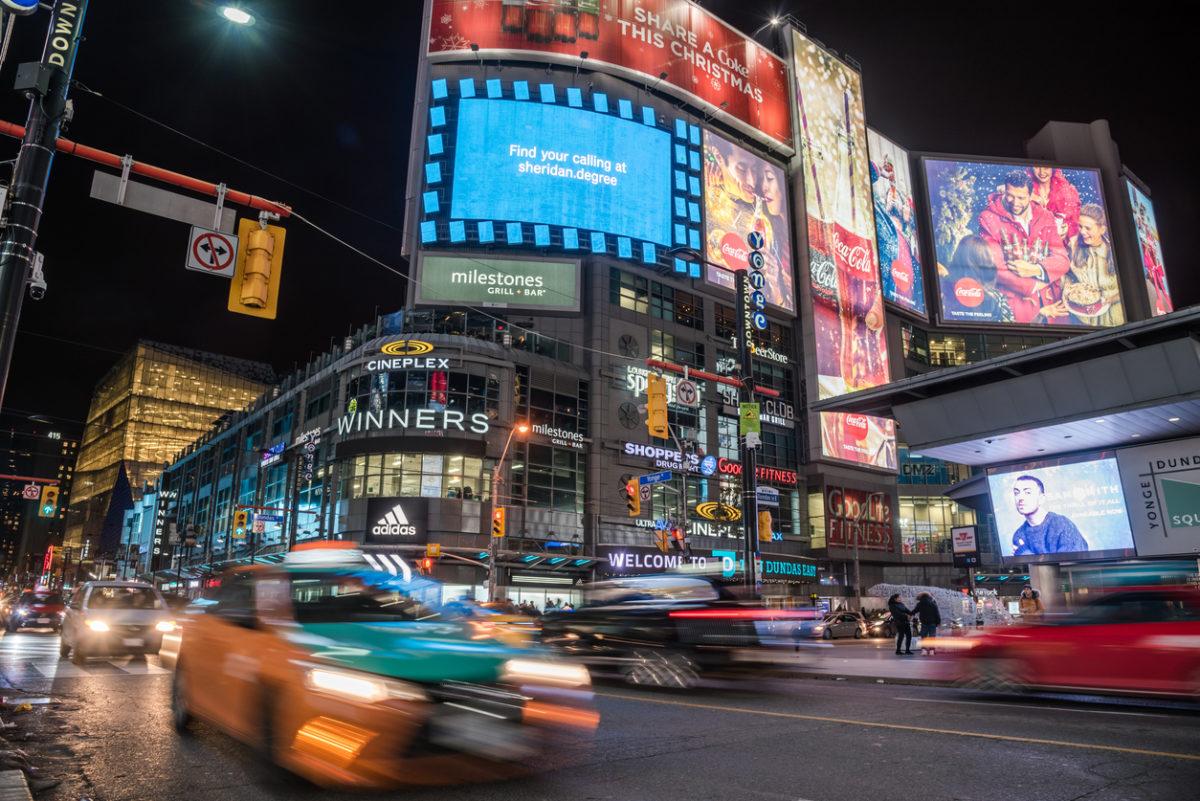 an image of cars driving through Toronto traffic at night
