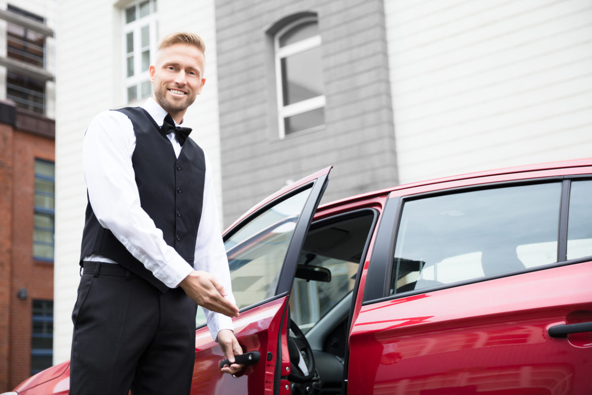 A Toronto Black Car Service driver opening the door to the car